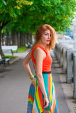 Young beautiful girl walks on the waterfront Stock Photography