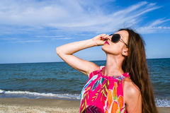 Young beautiful girl wearing sunglasses. At sea, sunny days summer vacation Stock Photos