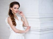 Young beautiful girl wearing white dress Stock Photo