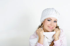 The young beautiful girl in a white cap. And a scarf with snowflakes on hair Stock Photography