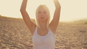 Young beautiful girl in white clothes doing yoga stock footage