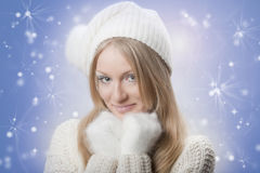 Young beautiful girl with white mitten Stock Image