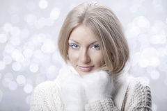 Young beautiful girl with white mitten Royalty Free Stock Photos
