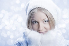 Young beautiful girl with white mitten Stock Photos