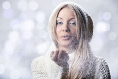 Young beautiful girl with white mitten Stock Photo