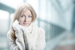 Young beautiful girl with white mitten Royalty Free Stock Images