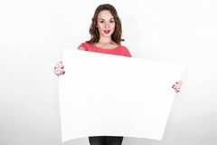 Young beautiful girl with white rectangular piece of paper Royalty Free Stock Image