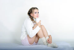 The young beautiful girl in a white scarf. With a mug Royalty Free Stock Images