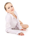 Young beautiful a girl in a white shirt posing Stock Images