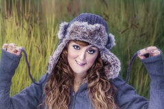 Young beautiful girl with winter clothes Royalty Free Stock Image