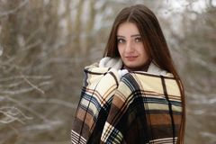 Young beautiful girl in winter snowy day Stock Photos