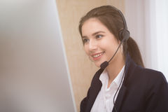 Young beautiful girl working at a laptop in a small medium enterprise Stock Images