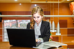 Young beautiful girl working on a laptop Royalty Free Stock Image