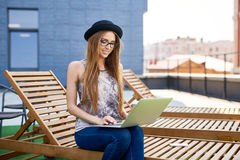 Young Beautiful Girl Working in Roof Lounge Stock Images
