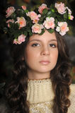Young beautiful girl with a wreath Royalty Free Stock Image