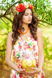 Young beautiful girl in a wreath of flowers with lemonade Royalty Free Stock Images