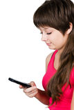 Young beautiful girl writes sms. isolated Royalty Free Stock Images