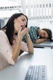 Young beautiful girl yawning during class Stock Image