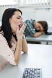 Young beautiful girl yawning during class Royalty Free Stock Photo
