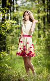Young beautiful girl in a yellow dress in the woods. Portrait of romantic woman in fairy forest. Stunning fashionable teenager. Young beautiful girl in a yellow stock image