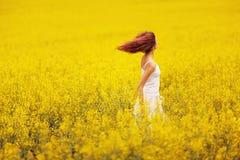 Beautiful girl in the yellow field stock image