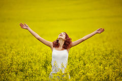 Young beautiful girl in yellow field Royalty Free Stock Images