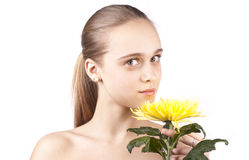 Young beautiful girl with yellow flower Royalty Free Stock Image