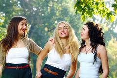 Young and beautiful girlfriends have fun in park Stock Photos