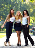 Young and beautiful girlfriends have fun in park Royalty Free Stock Photos