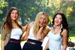 Young and beautiful girlfriends have fun in park Stock Image