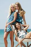 Young beautiful girls on beach Royalty Free Stock Photos
