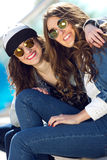 Young beautiful girls with denim suit in a urban background Royalty Free Stock Photography