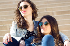 Young beautiful girls with denim suit in a urban background Royalty Free Stock Image