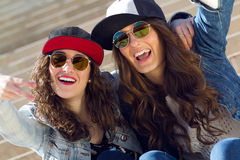 Young beautiful girls with denim suit in a urban background Stock Image