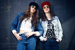 Young beautiful girls with denim suit in a urban background Royalty Free Stock Photo