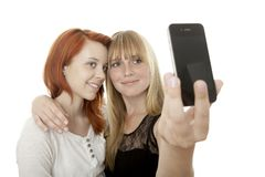 Young beautiful girls doing a self portrait Royalty Free Stock Photo