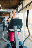Young beautiful girls exercising in the gym with ski machine stock photo