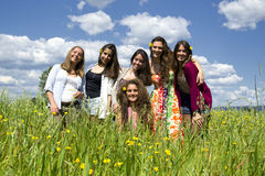 Young and beautiful girls on a field. Royalty Free Stock Photography