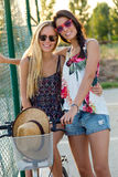 Young beautiful girls having fun in the park. Stock Images