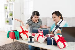 Young beautiful girls receive summer sale gift. Box feeling unhappy Stock Image