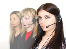 Young beautiful girls telephone operators. Beautiful young girls telephone operators in headphones Stock Images