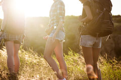 Young beautiful girls travelers walking in canyon at sunset. Royalty Free Stock Photography