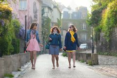 Young beautiful girls walking in Paris Royalty Free Stock Photo