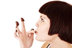Young beautiful glutton eat chocolate isolated. On white stock photos