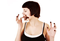 Young beautiful glutton eat chocolate isolated. On white royalty free stock image
