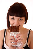 Young beautiful glutton eat chocolate isolated. On white stock photography