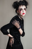 Young beautiful gothic woman with white skin and red lips. Halloween Royalty Free Stock Photo