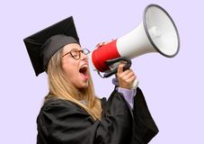 Young beautiful graduate woman student stock photo