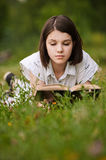 Young beautiful grand woman reading Stock Photos
