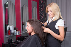 Young beautiful hairdresser at work Royalty Free Stock Photography